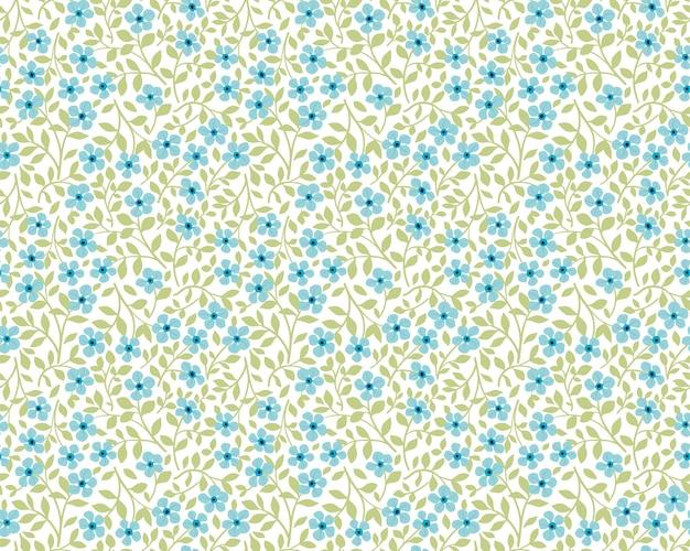 Weinleseblumenhintergrund. nahtloses muster für design- und modedrucke. blumenmuster mit kleinen blauen blumen auf einem weißen hintergrund. ditsy stil.