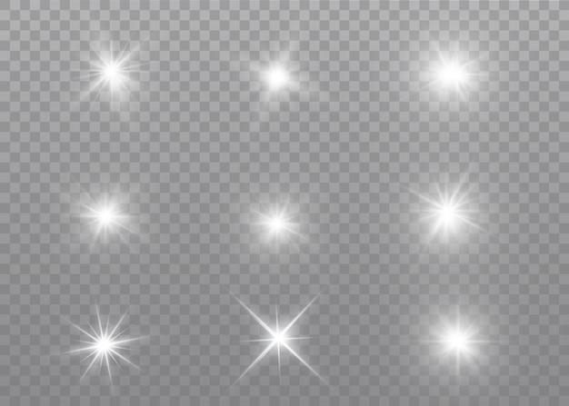 Weiß leuchtendes licht explodiert. funkelnde magische staubpartikel. heller stern. transparent strahlende sonne, heller blitz.
