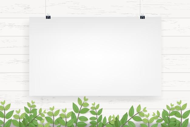 Weißbuchplakat, das am weißen hölzernen wandhintergrund hängt.