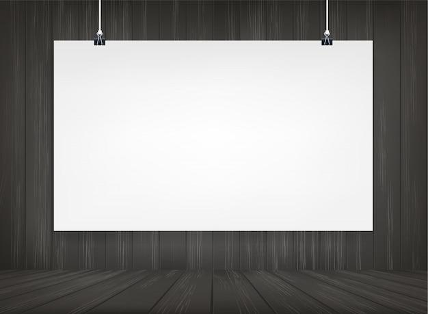 Weißbuchplakat, das mit hölzernem raumraumhintergrund hängt.