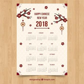 Weiße chinesische kalenderschablone des neuen jahres mit niederlassungen