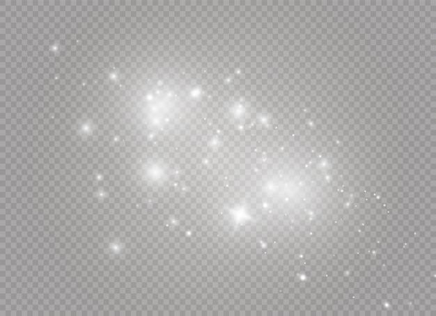 Weiße funken und goldene sterne glitzern als besonderer lichteffekt. funkelt auf transparentem hintergrund. abstraktes weihnachtsmuster. funkelnde magische staubpartikel.