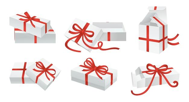 Weiße geschenkbox bögen set container mit rotem band klebeband dekoration verschiedene kartonschablonen schablonensammlung leere pappgestaltung geburtstagsfeier weihnachtsfeier
