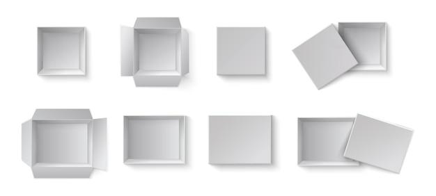 Weiße leere verpackungsgeschenkboxen. eine reihe von offenen und geschlossenen kisten in verschiedenen winkeln.