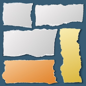 Weiße papierschnipsel. zerrissene notizbücher. schrottsammlung