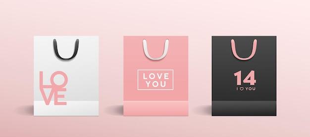 Weiße papiertüte, rosa papiertüte, schwarze papiertüte, mit buntem stoffgriff sammelt valentinskonzeptentwurf, schablonenhintergrund