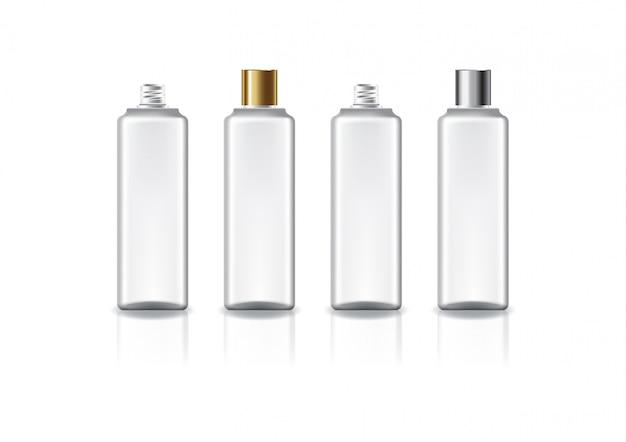 Weiße quadratische kosmetikflasche mit zweifarbigem gold-silberfarbenem schraubdeckel.