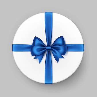 Weiße runde geschenkbox mit glänzend blauer satinschleife und band