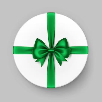 Weiße runde geschenkbox mit glänzend grüner satinschleife und band