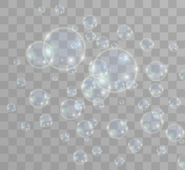 Weiße schöne blasen auf einem transparenten hintergrund. seifenblasen.