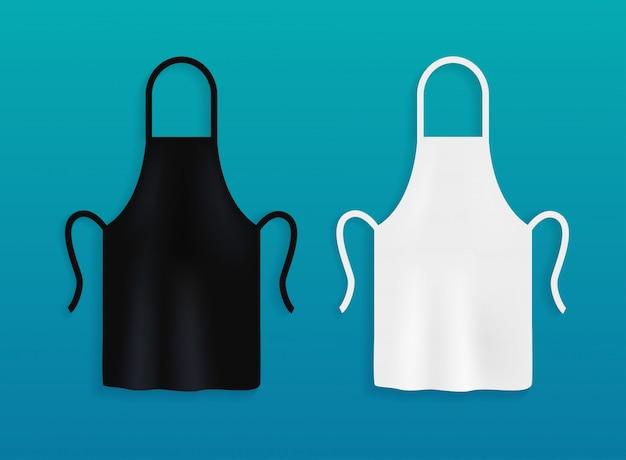 Weiße und schwarze küchenschürzen. kochuniform zum kochen.