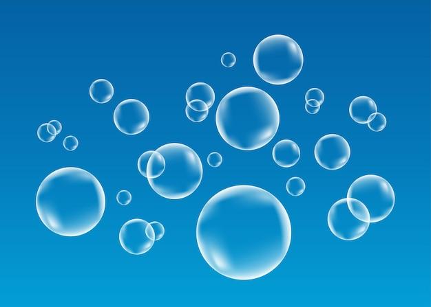 Weiße unter wasser sprudelnde luftblasen auf blauem hintergrund