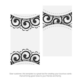 Weiße visitenkartenschablone mit schwarzer abstrakter verzierung