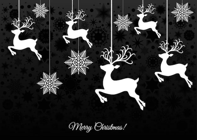 Weiße weihnachtsdekoration auf schwarzem hintergrund xmas ball rentiere und schneeflocken