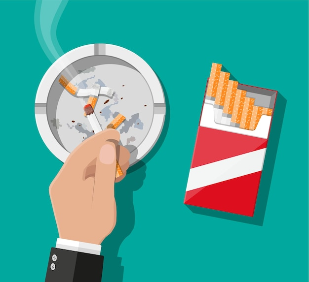 Weißer keramikaschenbecher voller rauchender zigaretten