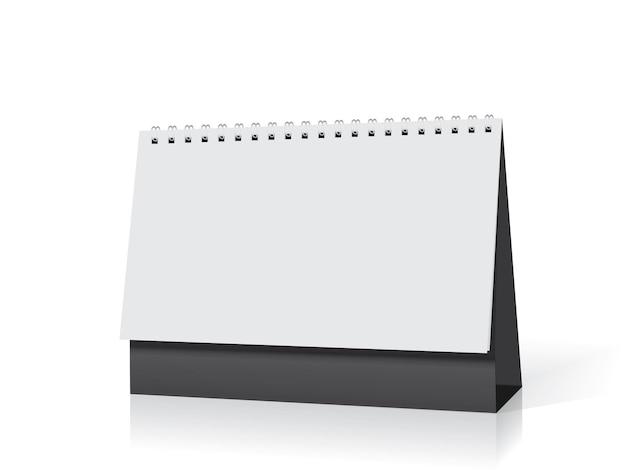 Weißer papierkalender steht auf dem tisch
