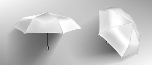 Weißer regenschirm, leere sonnenschirmfront