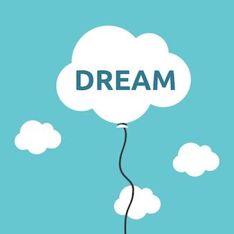Weißer wolkenförmiger ballon mit traumwort, das hoch im himmel fliegt