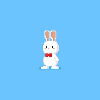 Weißes kaninchenzeichen des pixels mit roter fliege Premium Vektoren