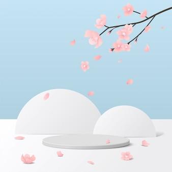 Weißes podium des zylinders im weißen und blauen hintergrund mit rosa sakura-blume. produktpräsentation, szene zur präsentation eines kosmetischen produkts, podium, bühnensockel oder plattform.