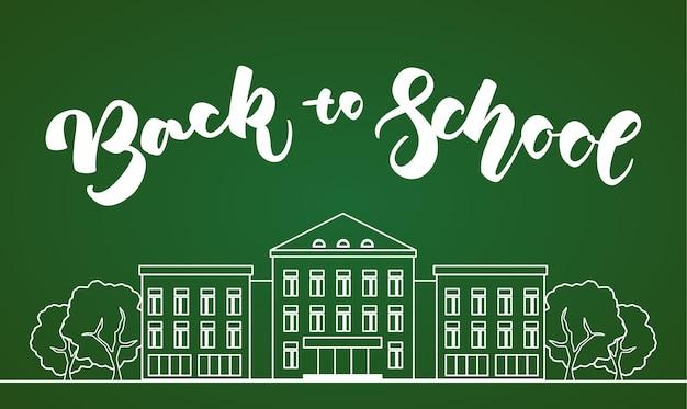 Weißes schulgebäude der flachen linie mit bäumen und handbeschriftung zurück zur schule auf grünem tafelhintergrund