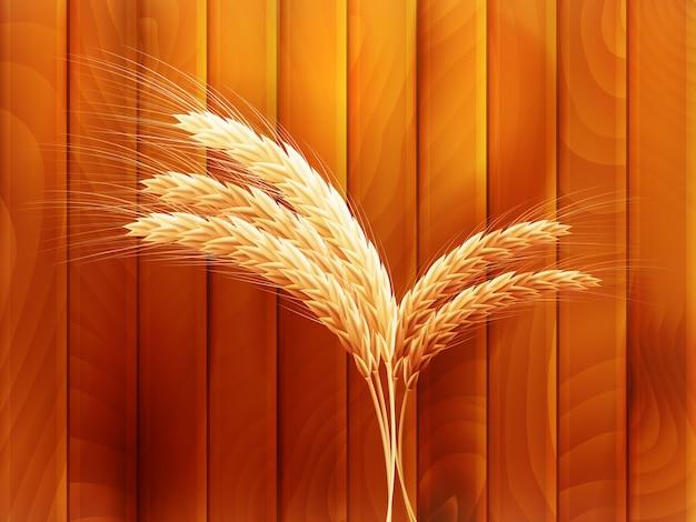 Weizen auf hölzernem herbsthintergrund.