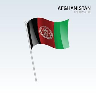 Wellenartig bewegende flagge afghanistans lokalisiert auf grauem hintergrund