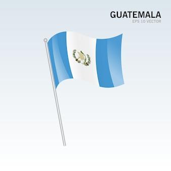Wellenartig bewegende flagge guatemalas lokalisiert auf grauem hintergrund