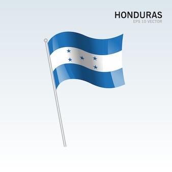 Wellenartig bewegende flagge honduras lokalisiert auf grauem hintergrund
