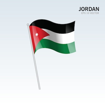 Wellenartig bewegende flagge jordaniens lokalisiert auf grauem hintergrund