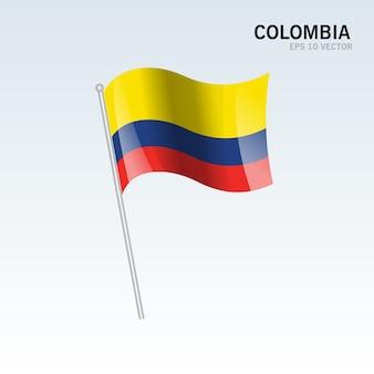 Wellenartig bewegende flagge kolumbiens lokalisiert auf grauem hintergrund
