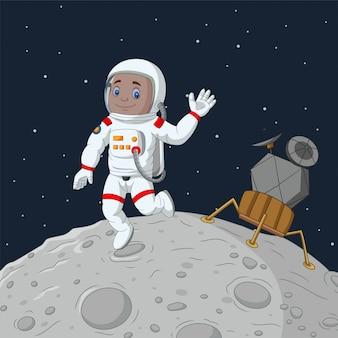 Wellenartig bewegende hand des karikaturjungenastronauten