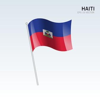 Wellenartig bewegende markierungsfahne haitis lokalisiert auf grauem hintergrund