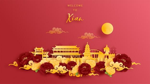 Weltberühmtes wahrzeichen von xian, china in gold und rotem hintergrund. papierschnitt.