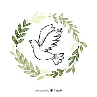 Weltfriedenstaghintergrund mit gezeichneter art der taube in der hand