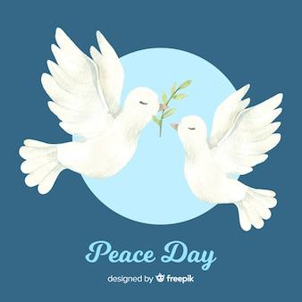 Weltfriedenstaghintergrund mit gezeichneter art der tauben in der hand