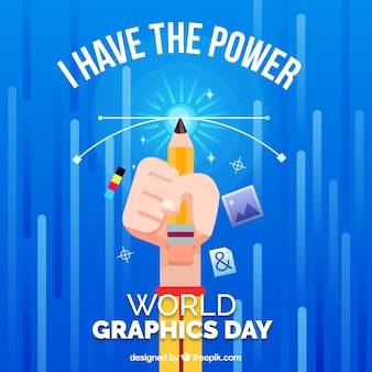 Weltgrafik-tageshintergrund mit der hand, die einen bleistift hält