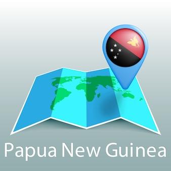 Weltkarte der papua-neuguinea-flagge im stift mit dem namen des landes auf grauem hintergrund