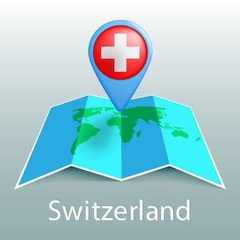 Weltkarte der schweizflagge im stift mit dem namen des landes auf grauem hintergrund