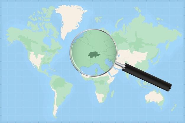 Weltkarte mit einer lupe auf einer karte der schweiz.