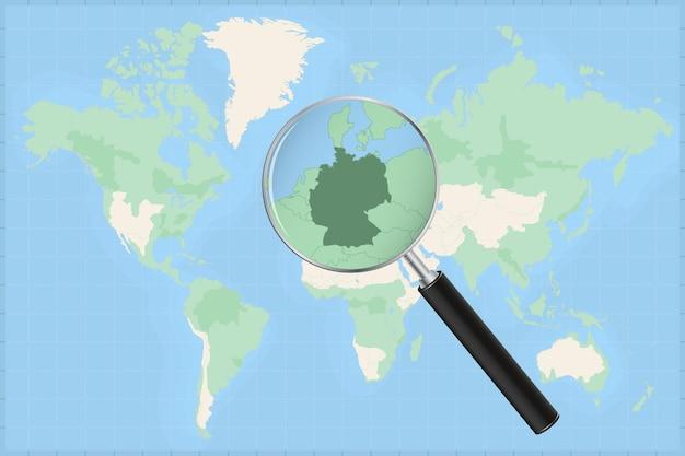 Weltkarte mit einer lupe auf einer karte von deutschland