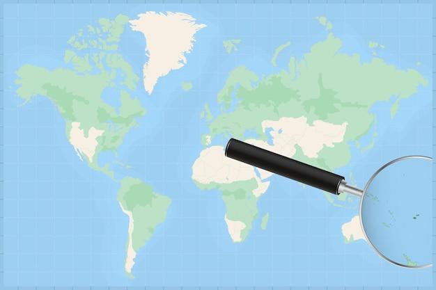 Weltkarte mit einer lupe auf einer karte von fidschi.