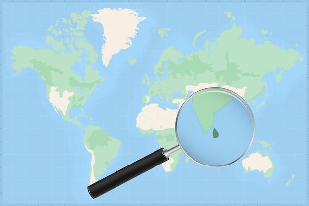 Weltkarte mit einer lupe auf einer karte von sri lanka.