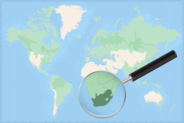 Weltkarte mit einer lupe auf einer karte von südafrika.