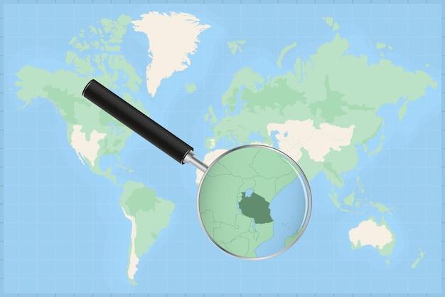 Weltkarte mit einer lupe auf einer karte von tansania.
