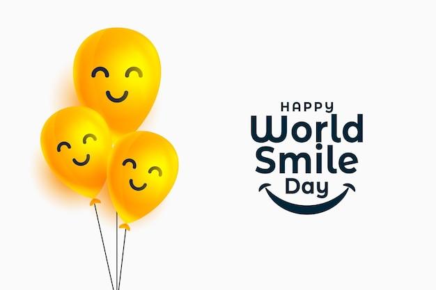 Weltlächeln-tagesbanner mit glücklichen gesichtsballons