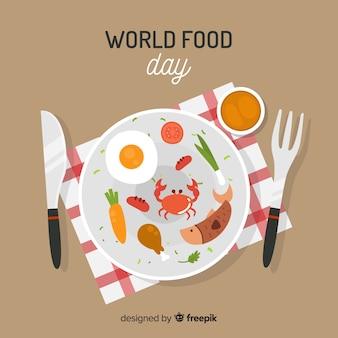 Weltnahrungsmitteltageshintergrund mit lebensmittel auf teller