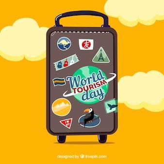 Welttourismus tag mit reisetasche und wolken
