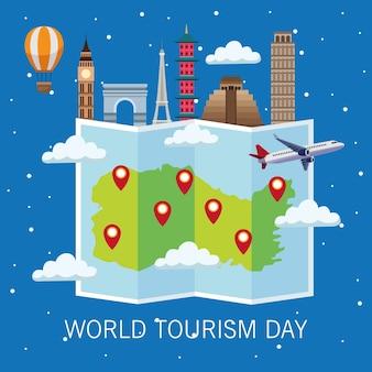 Welttourismus-tageskarte mit papierkarte und denkmalvektorillustrationsdesign