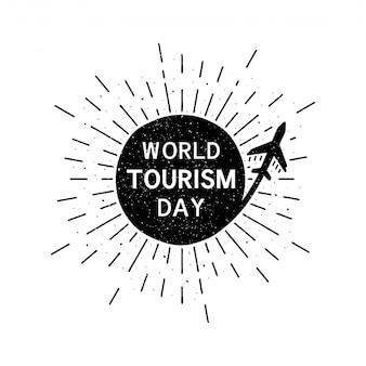 Welttourismustag mit schriftzug. feiertags-schmutz-weinleseillustration